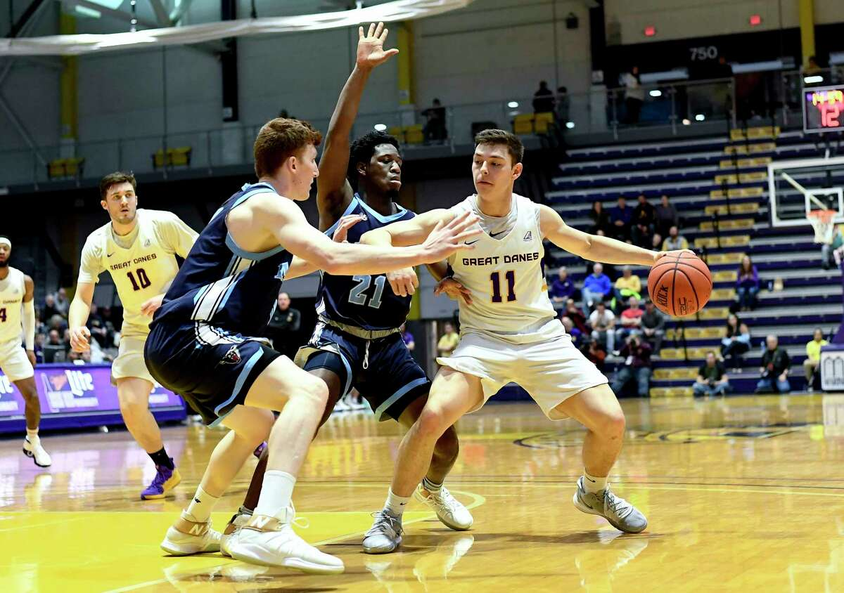 University at Albany guard Cameron Healy (11) moves the ball against Maine during the first half of an NCAA basketball game Saturday Jan. 11, 2020, in Albany, N.Y. (Hans Pennink / Special to the Times Union)