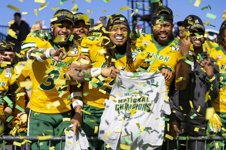 North Dakota State linebackers Jasir Cox (31), Aaron Mercadel (55), and Jabril Cox (42) celebrate after beating James Madison in the FCS championship game. Photo: Sam Hodde / Associated Press