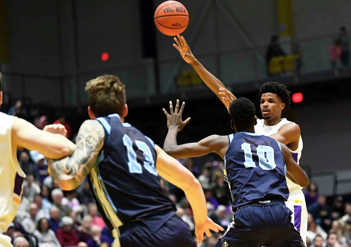 University at Albany forwar dRomani Hansen (32) passes the ball against Maine during the first half of an NCAA basketball game Saturday Jan. 11, 2020, in Albany, N.Y. (Hans Pennink / Special to the Times Union)