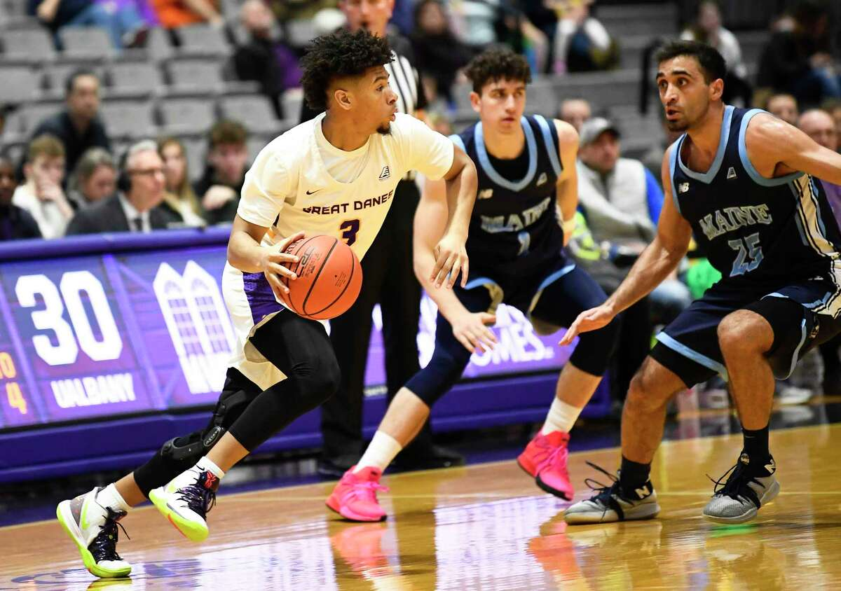 University at Albany guard JoJo Anderson (3) moves the ball against Maine during the first half of an NCAA basketball game Saturday Jan. 11, 2020, in Albany, N.Y. (Hans Pennink / Special to the Times Union)