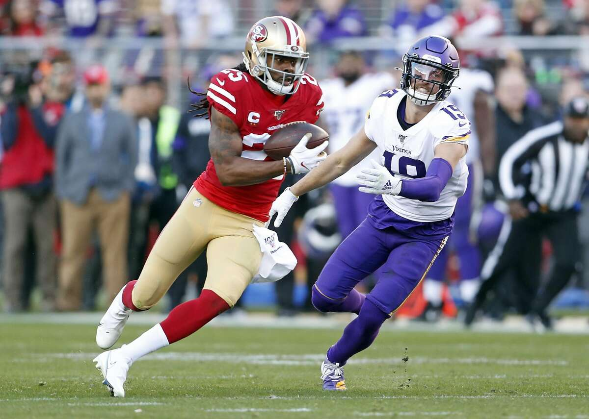 San Francisco 49ers' Richard Sherman intercepts a pass intended for Minnesota Vikings' Adam Thielen in 3rd quarter during Niners' 27-10 win in NFC Divisional playoff game at Levi's Stadium in Santa Clara, Calif., on Saturday, January 11, 2020.