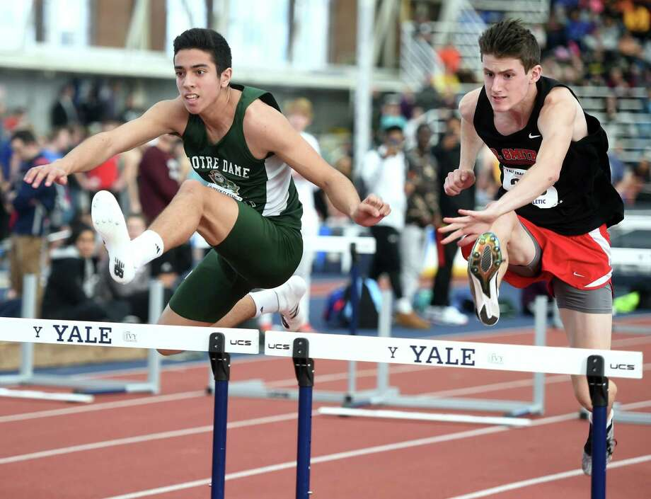 Notre Dame-West Haven's Jared Russo, left, runs in the 55 meters hurdles championship semifinals at the Yale Interscholastic Track Classic at Coxe Cage in New Haven earlier this month. Photo: Arnold Gold / Hearst Connecticut Media / New Haven Register