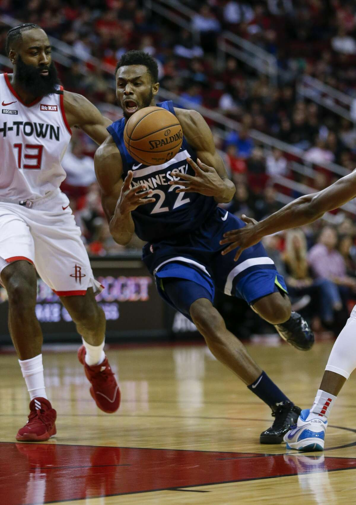 Minnesota Timberwolves forward Andrew Wiggins (22) regains possession of the ball mid-dribble against the Houston Rockets during the first half of an NBA game at the Toyota Center Saturday, Jan. 11, 2020, in Houston. The Rockets won 139-109.