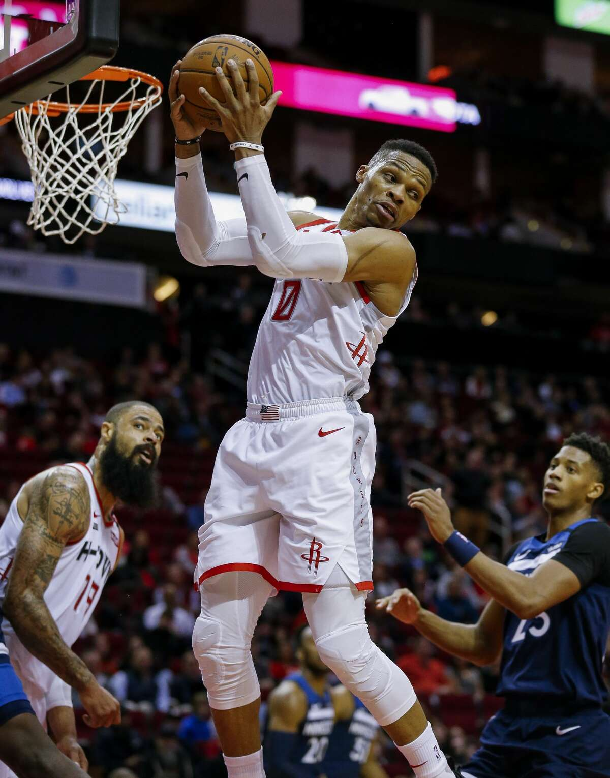 Houston Rockets guard Russell Westbrook (0) rebounds the ball against the Minnesota Timberwolves during the first half of an NBA game at the Toyota Center Saturday, Jan. 11, 2020, in Houston. The Rockets won 139-109.