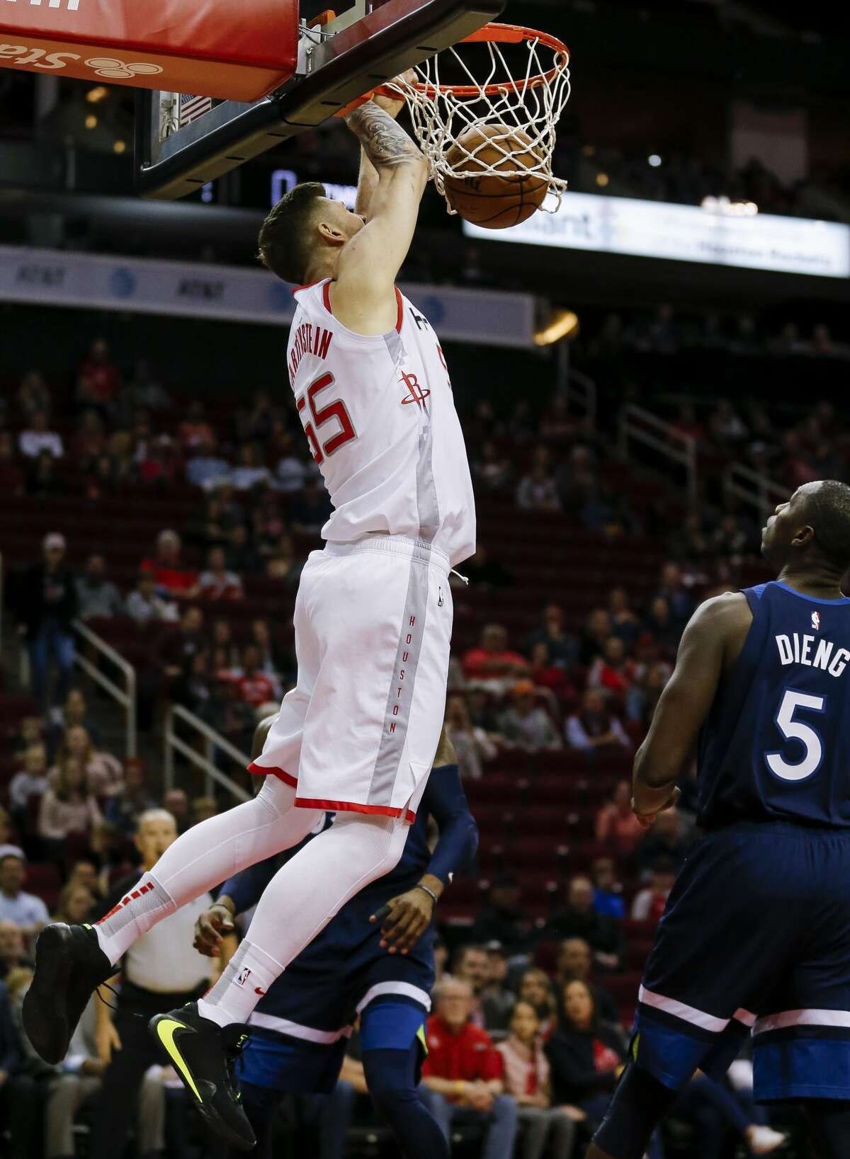 Houston Rockets center Isaiah Hartenstein (55) dunks the ball against the Minnesota Timberwolves during the first half of an NBA game at the Toyota Center Saturday, Jan. 11, 2020, in Houston. The Rockets won 139-109.