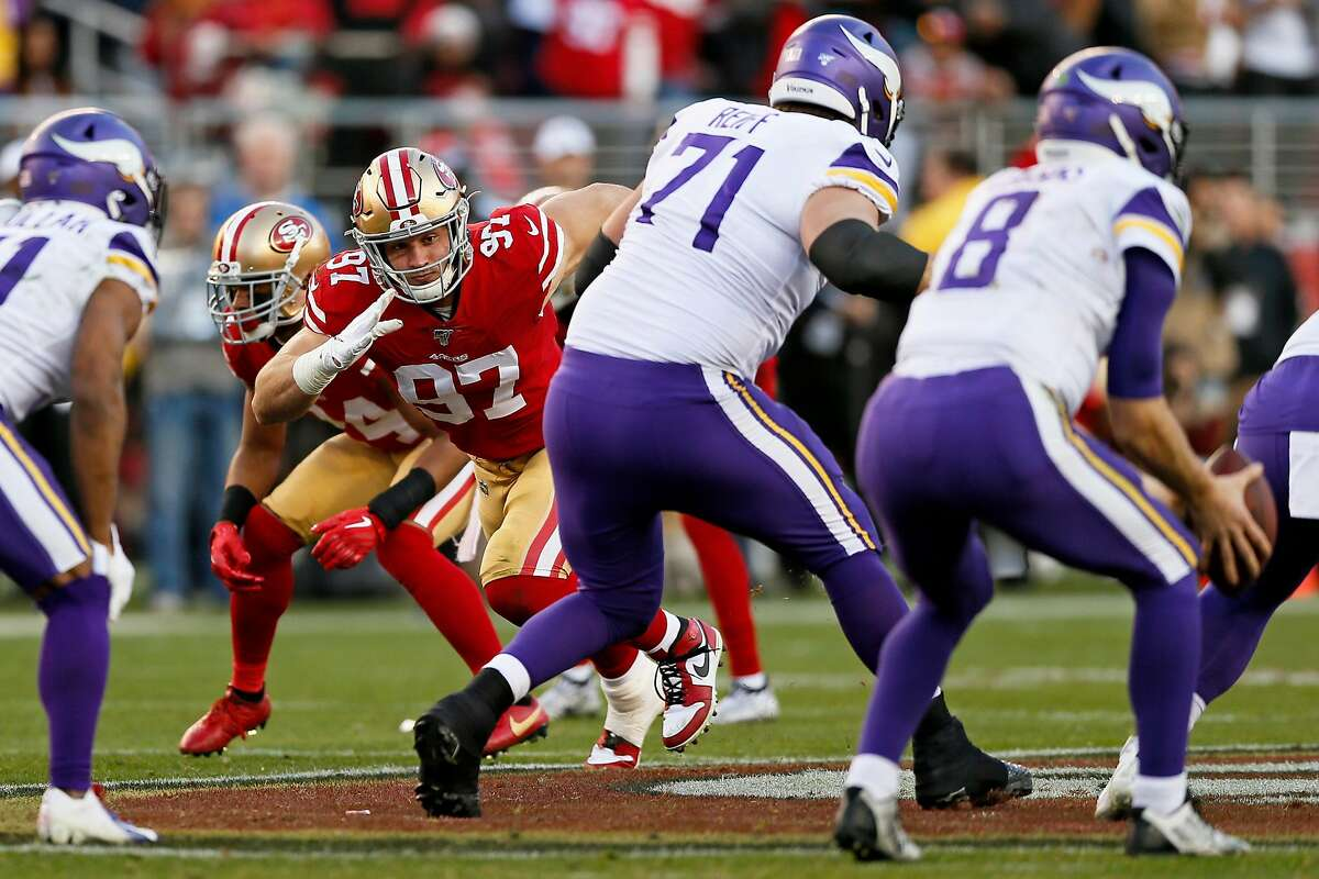 San Francisco 49ers defensive end Nick Bosa (97) rushes and pressures Minnesota Vikings quarterback Kirk Cousins (8) in the second half of an NFC Divisional Round playoff game at Levi's Stadium on Saturday, Jan. 11, 2020, in Santa Clara, Calif. The 49ers won 27-10.
