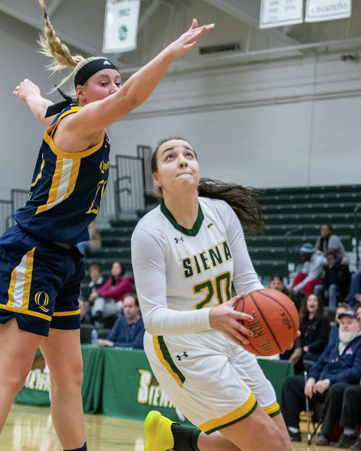 Siena College sophomore Margo Peterson drives to the basket underneath Quinnipiac University senior Paige Warfel at the Siena College Alumni Recreation Center in Colonie, NY on Saturday, Jan. 4, 2020 (Jim Franco/Special to the Times Union.)