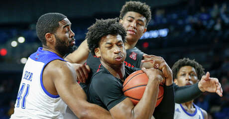 Houston guard Nate Hinton (11) secures a rebound against Tulsa forward Jeriah Horne (41) and Houston guard Quentin Grimes (24) during an NCAA college basketball game at the Reynolds Center in Tulsa, Okla., Saturday, Jan. 11, 2020. (Ian Maule/Tulsa World via AP)