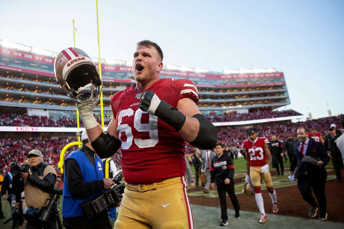 San Francisco 49ers offensive tackle Mike McGlinchey (69) greets fans as he exits the tunnel following the NFC Divisional Round playoff game against the Minnesota Vikings at Levi's Stadium on Saturday, Jan. 11, 2020, in Santa Clara, Calif. The 49ers won 27-10.