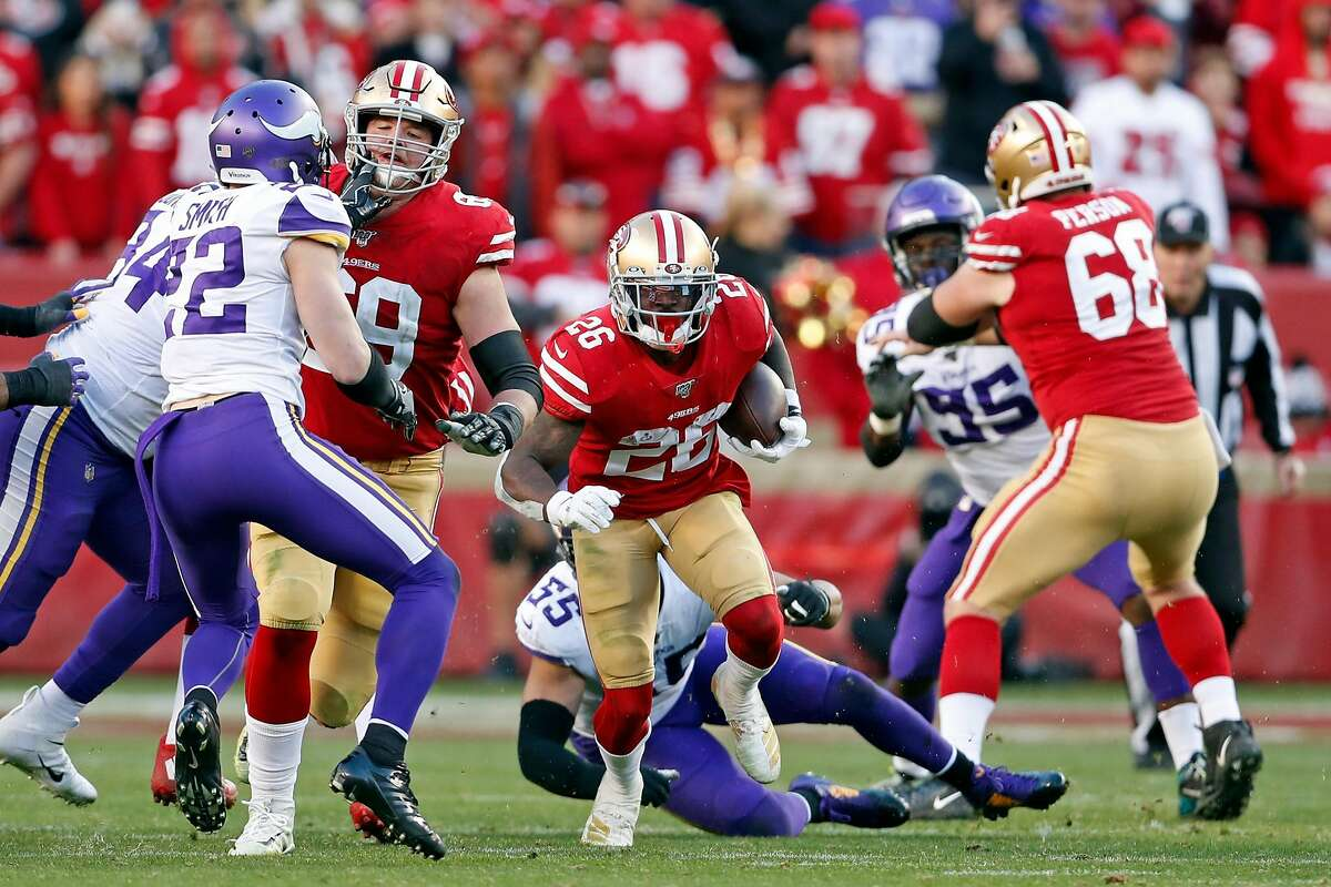 San Francisco 49ers' Tevin Coleman rushes in 4th quarter of Niners' 27-10 win over Minnesota Vikings in NFC Divisional playoff game at Levi's Stadium in Santa Clara, Calif., on Saturday, January 11, 2020.