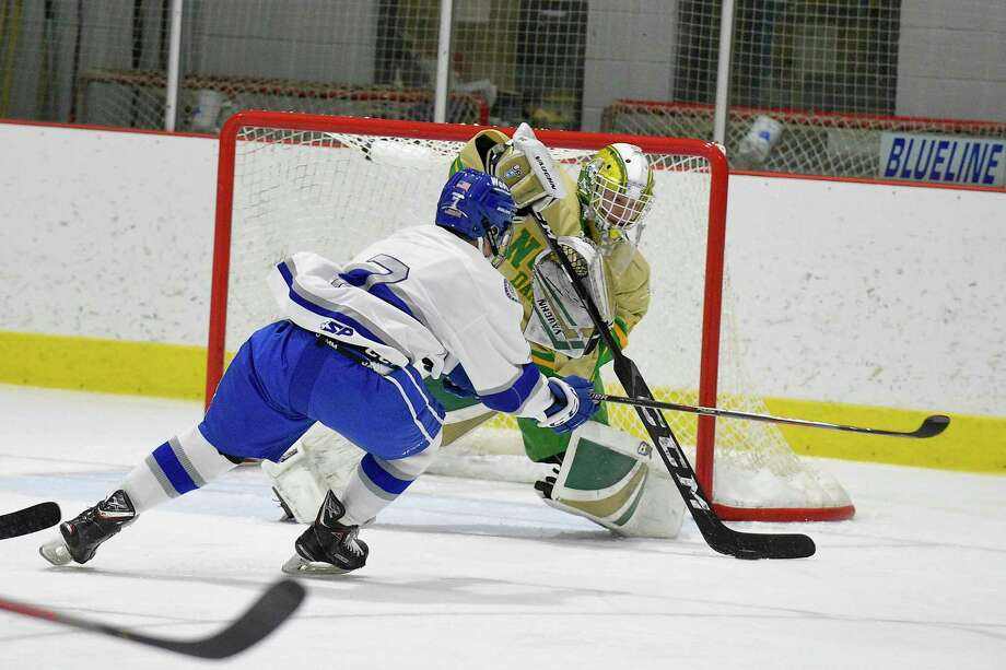 Darien's Sam Erickson (7) has his shot stopped by Notre Dame-West Haven goalie Connor Smith in the first period of a CIAC boys hockey match up at the Darien Ice House in Darien, Conn. on Jan. 11, 2020. Erickson hat trick on the night, along with two more Bluewave goals topped Notre Dame-West Haven Green Knights 5-2. Photo: Matthew Brown / Hearst Connecticut Media / Stamford Advocate
