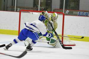 Darien's Sam Erickson (7) has his shot stopped by Notre Dame-West Haven goalie Connor Smith in the first period of a CIAC boys hockey match up at the Darien Ice House in Darien, Conn. on Jan. 11, 2020. Erickson hat trick on the night, along with two more Bluewave goals topped Notre Dame-West Haven Green Knights 5-2.