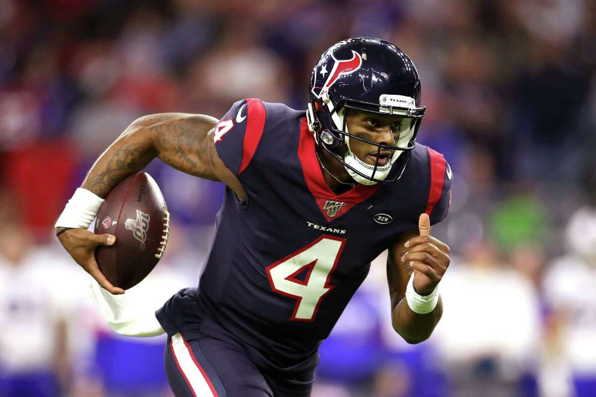 HOUSTON, TEXAS - JANUARY 04: Deshaun Watson #4 of the Houston Texans runs the ball for a touchdown against the Buffalo Bills during the third quarter of the AFC Wild Card Playoff game at NRG Stadium on January 04, 2020 in Houston, Texas. (Photo by Christian Petersen/Getty Images)