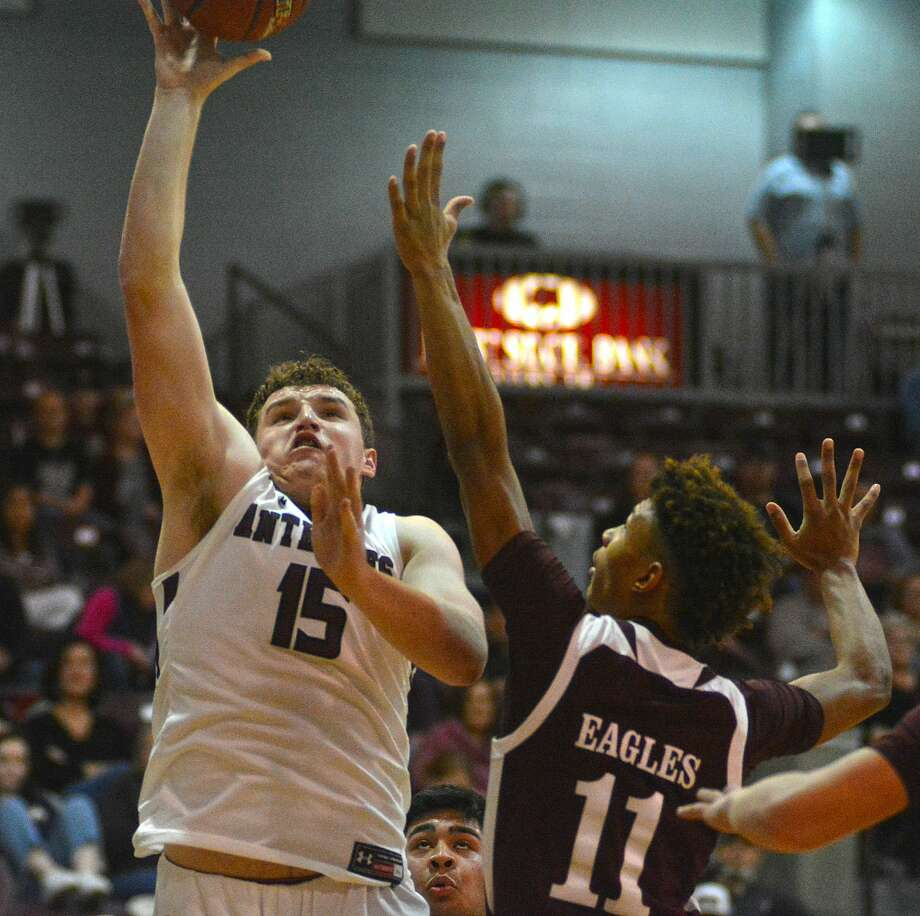 Abernathy's Miles Keith puts in the shot over Lubbock Roosevelt defender Jacob Torrez during their District 2-3A boys basketball game on Friday in the Antelope Gym at Abernathy. Photo: Nathan Giese/Planview Herald