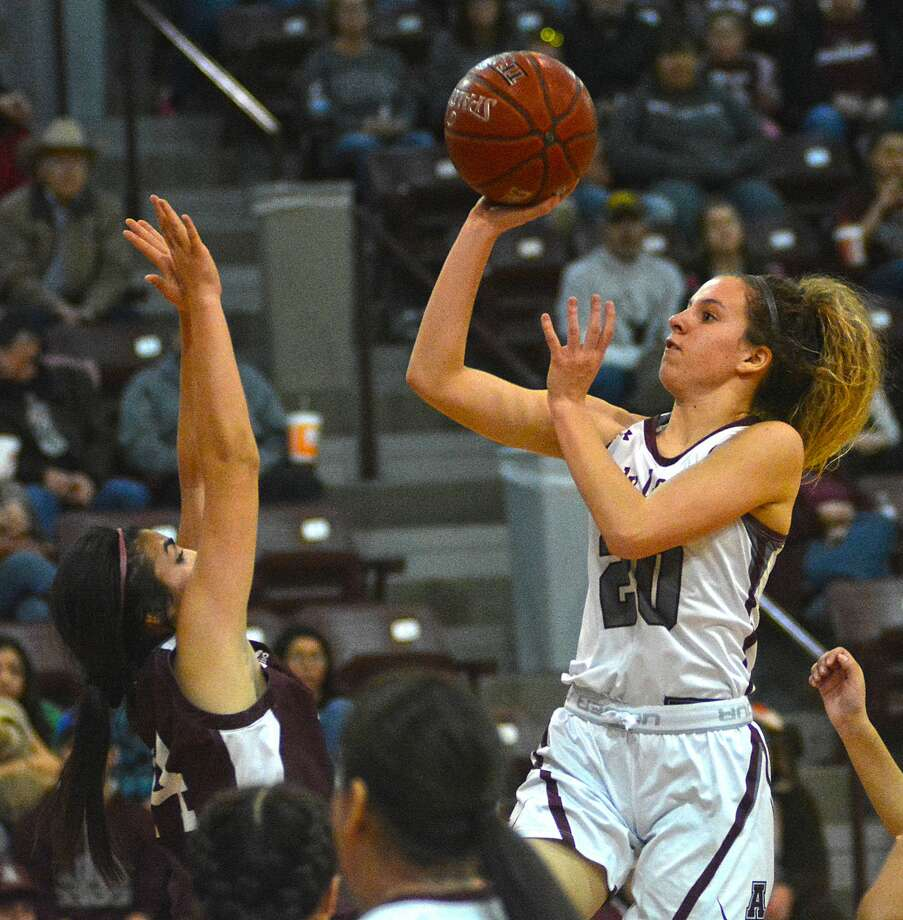 Abernathy's Chanie Chambers floats the shot over Lubbock Roosevelt defender Jasmin Rodriguez during their District 2-3A girls basketball game on Friday in Abernathy. Photo: Nathan Giese/Planview Herald