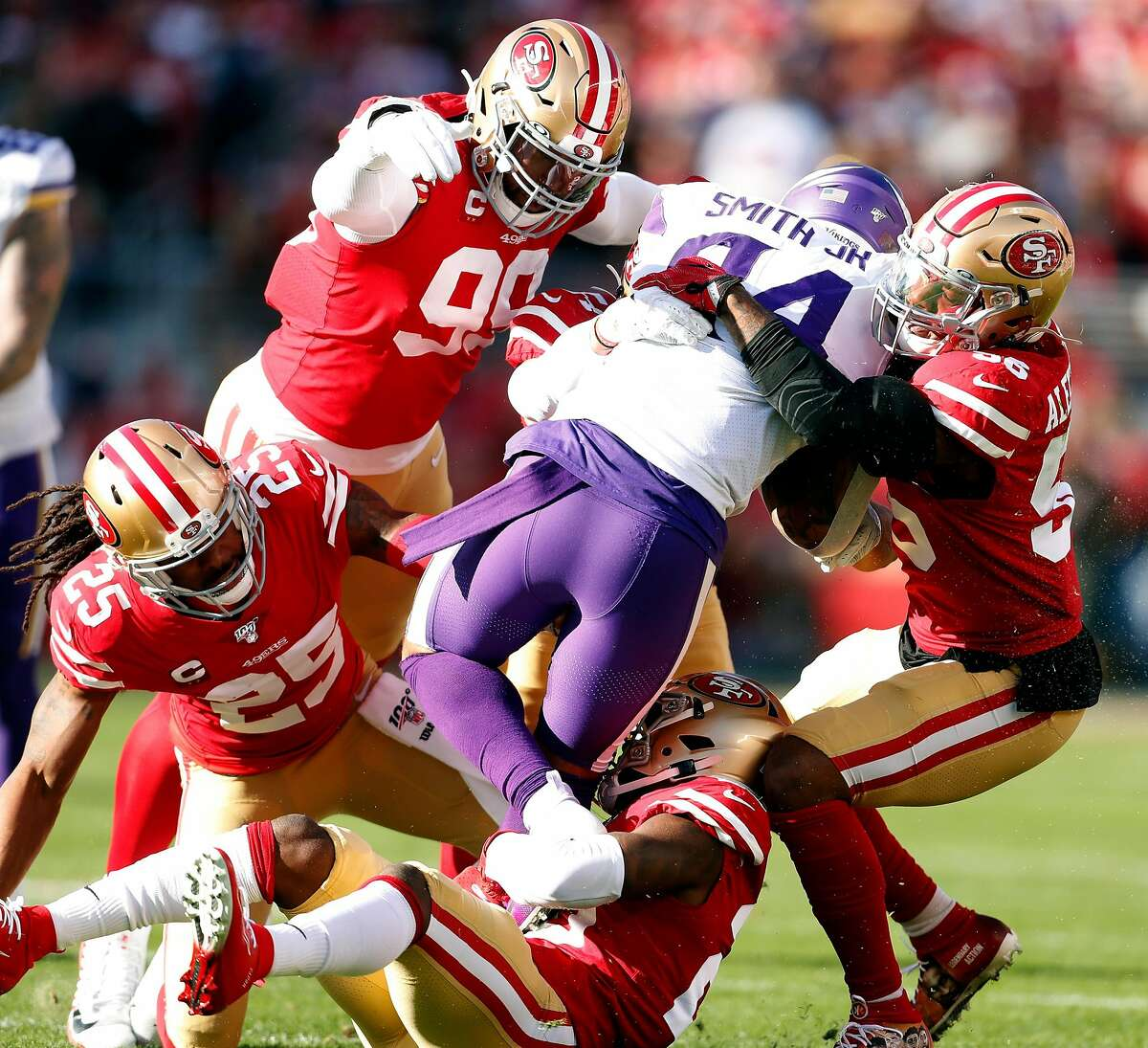San Francisco 49ers' Kwon Alexander, DeForest Buckner, Richard Sherman and Jimmie Ward team up to stop Minnesota Vikings' Irv Smith, Jr. in 1st quarter of Niners' 27-10 win during NFC Divisional playoff game at Levi's Stadium in Santa Clara, Calif., on Saturday, January 11, 2020.