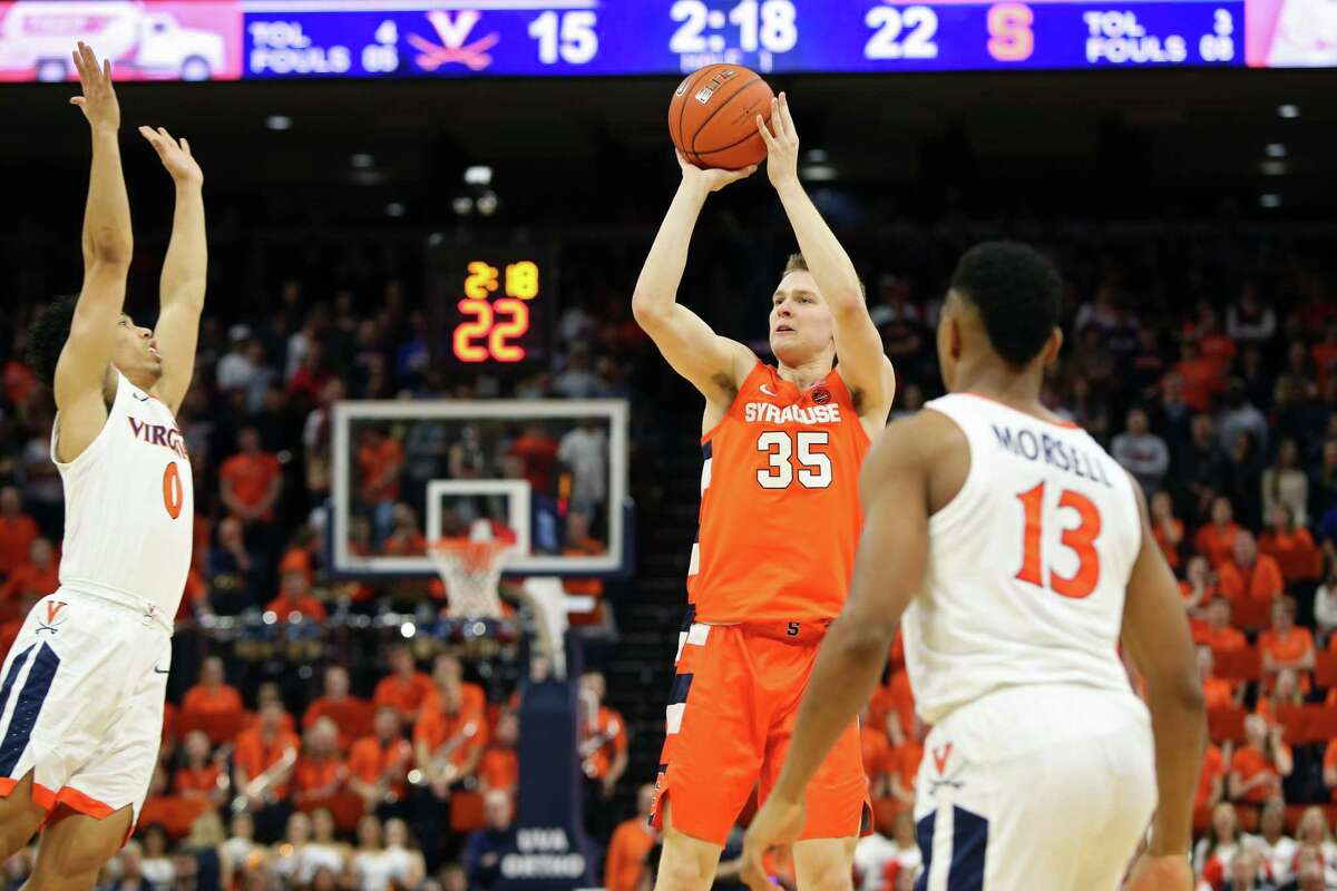 CHARLOTTESVILLE, VA - JANUARY 11: Buddy Boeheim #35 of the Syracuse Orange shoots between Kihei Clark #0 and Casey Morsell #13 of the Virginia Cavaliers in the first half during a game at John Paul Jones Arena on January 11, 2020 in Charlottesville, Virginia. (Photo by Ryan M. Kelly/Getty Images)