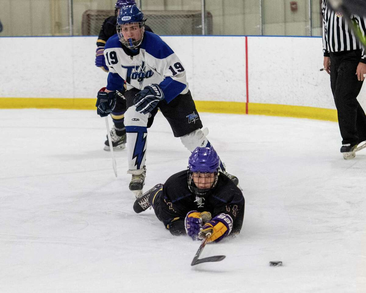 CBA defenseman Dale Hammond reaches for the puck in front of Saratoga forward Riley Lefebvre during a Capital District High School Hockey League game at the Albany County Hockey Facility in Colonie on Saturday, Jan. 11, 2019 (Jim Franco/Special to the Times Union.)