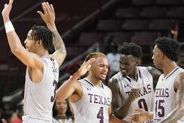 Texas Southern University Bryson Etienne (4) celebrates with teammates Eden Ewing (3), Yahuza Rasas (0) and Justin Hopkins (15) after scoring and drawing a foul in the final seconds of game against Prairie View A&M at TSU Saturday, Jan. 11, 2020, in Houston.