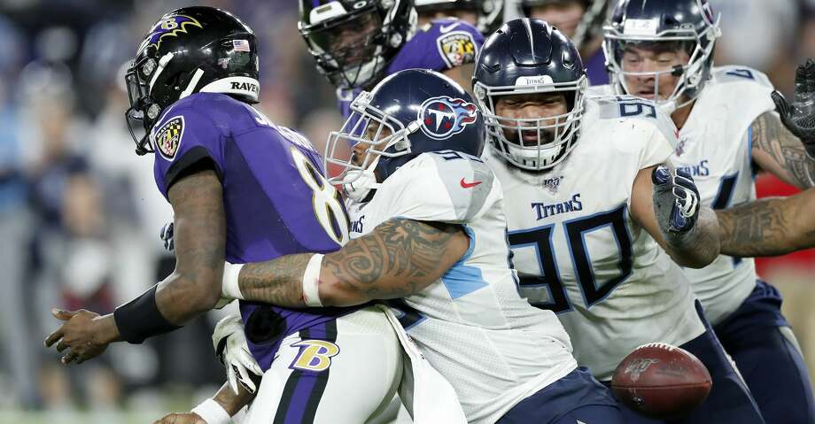 BALTIMORE, MARYLAND - JANUARY 11: Jurrell Casey #99 of the Tennessee Titans tackles quarterback Lamar Jackson #8 of the Baltimore Ravens to cause a fumble during the AFC Divisional Playoff game at M&T Bank Stadium on January 11, 2020 in Baltimore, Maryland. (Photo by Todd Olszewski/Getty Images) Photo: Todd Olszewski/Getty Images
