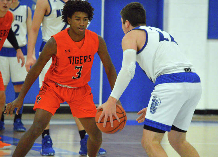 Edwardsville's Gabe James, left, guards a Freeburg player during the second quarter of Saturday's non-conference game at Freeburg.