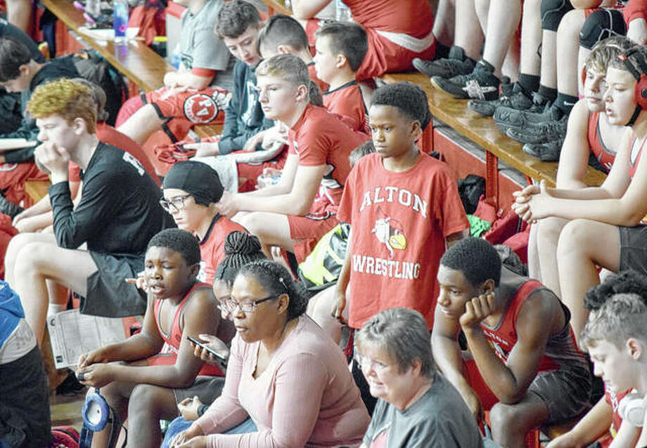 Alton Middle School wrestlers cheer on a teammate. Photo: Marco Cartolano   Journal-Courier
