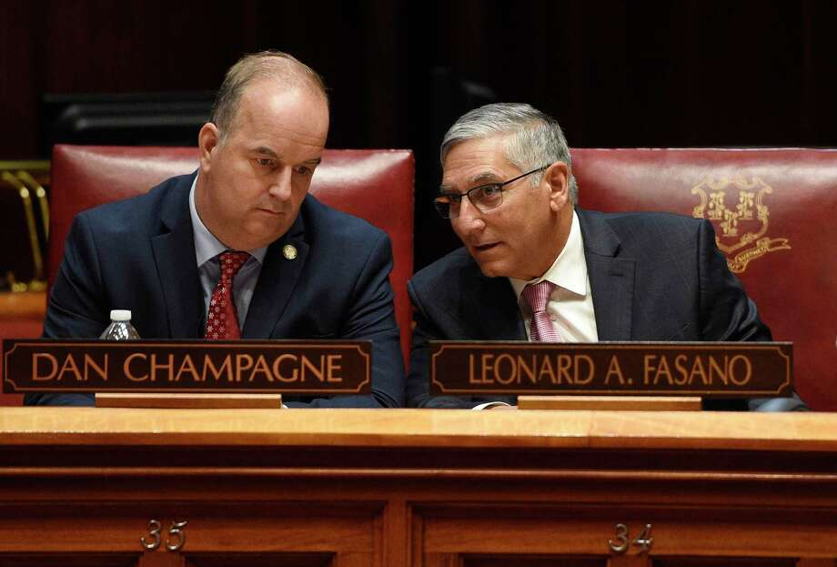 State Sen. Dan Champagne, R-Vernon, left, talks with Senate Minority Leader Len Fasano, R-North Haven, during special session at the State Capitol in Hartford, Conn., Wednesday, Dec. 18, 2019. Photo: Jessica Hill / Associated Press / Copyright 2019 The Associated Press. All rights reserved.