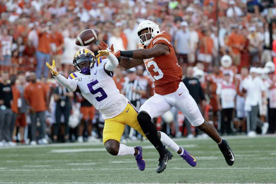 LSU cornerback Kary Vincent Jr. (5) breaks up a pass intended for Texas wide receiver Brennan Eagles (13) during the first half of an NCAA college football game Saturday, Sept. 7, 2019, in Austin, Texas. (AP Photo/Eric Gay) Photo: Eric Gay, STF / Associated Press / Copyright 2019 The Associated Press. All rights reserved.