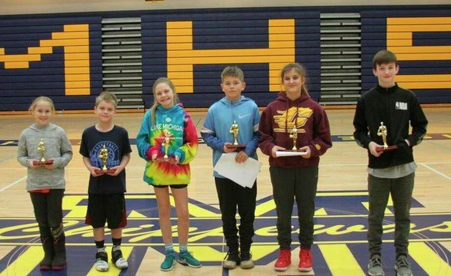 Winners in Saturday's Manistee Elks Lodge local Hoop Shoot Contest are (left to right)Melodie Stove (girls 8-9 age), Ryder Girven (boys 8-9 age), Lindsey Gardner (girls 10-11 age), Dalton Mobley (boys 10-11 age), Paige Gutowski (girls 12-13 age) and Matthew Burkhart (boys 12-13 age). (Ken Grabowski/News Advocate)