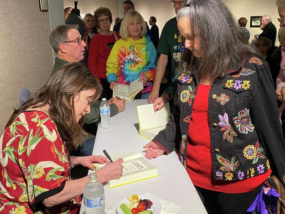 Holly George-Warren, left sign a copy of her book Janis: Her Life and Music at the Museum of the Gulf Coast on Saturday. Photo: Chris Moore