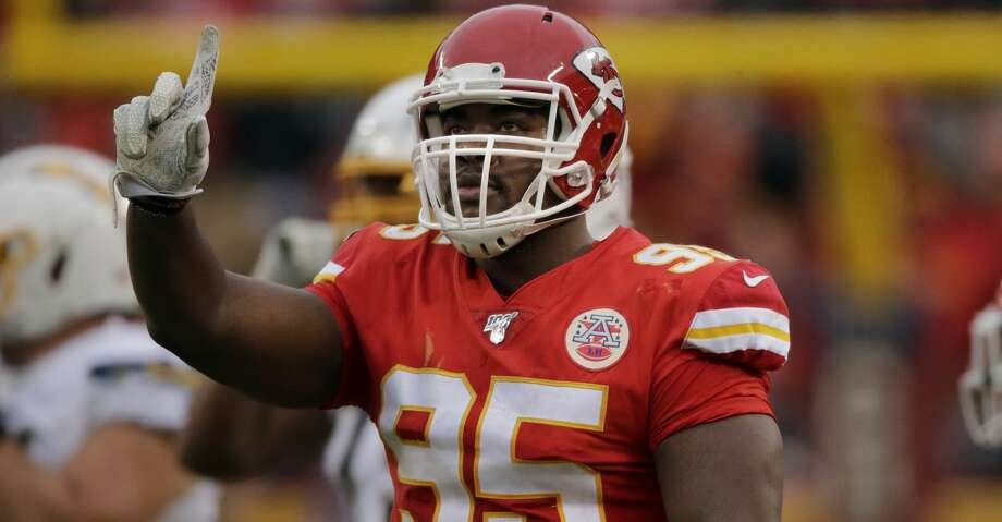 Kansas City Chiefs defensive tackle Chris Jones (95) gestures after tackling Los Angeles Chargers running back Austin Ekeler during the second half of an NFL football game in Kansas City, Mo., Sunday, Dec. 29, 2019. (AP Photo/Charlie Riedel) Photo: Charlie Riedel/Associated Press