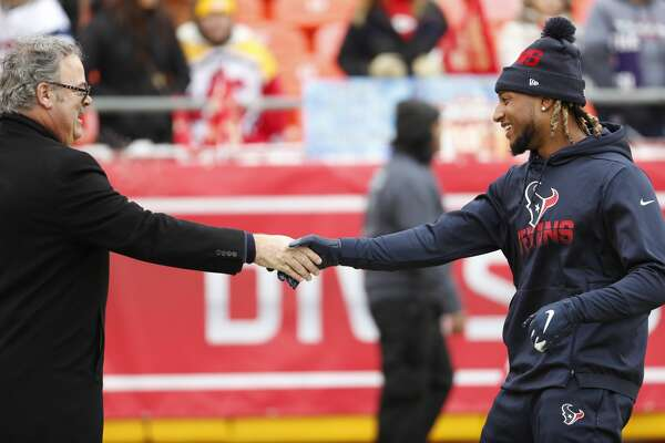 Houston Texans chairman and CEO Cal McNair shakes hands with Texans strong safety Justin Reid before an AFC divisional playoff game at Arrowhead Stadium on Sunday, Jan. 12, 2020, in Kansas City, Mo.