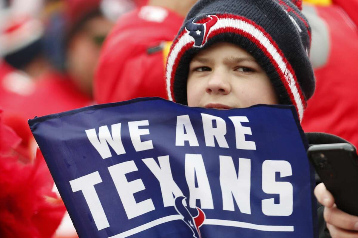 Houston Texans fans watch warm ups before an AFC divisional playoff game against the Kansas City Chiefs at Arrowhead Stadium on Sunday, Jan. 12, 2020, in Kansas City, Mo.