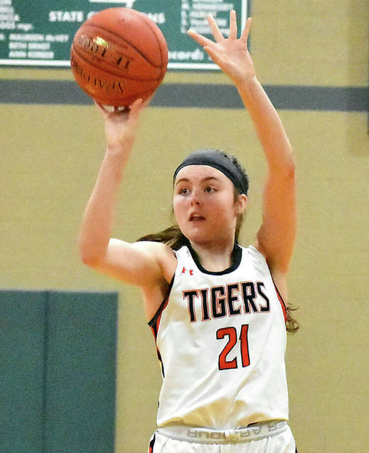 Edwardsville's Elle Evans hits an open 3-pointer Saturday in the Tigers' win over Parkway North at the St. Joseph's Academy Shootout in St. Louis. Photo: Matt Kamp / Hearst Midwest