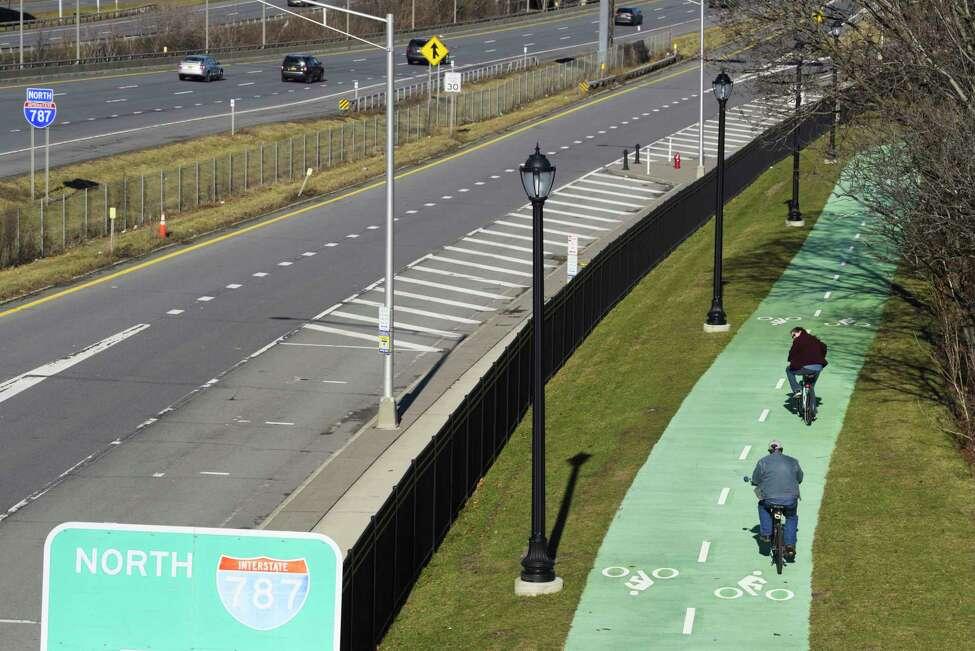 People ride bikes along a path near Interstate 787 on Sunday, Jan. 12, 2020, in Albany, N.Y. (Paul Buckowski/Times Union)