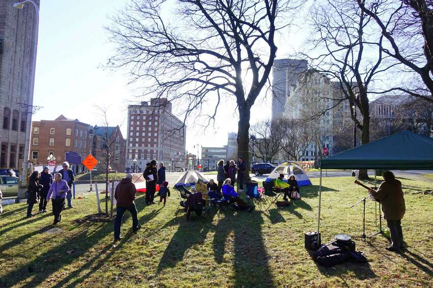 People gather at Academy Park for an encampment on Sunday, Jan. 12, 2020, in Albany, N.Y. The encampment is being held to show their support for the asylum-seekers at the U.S.-southern border living in tent encampments. The encampment is being hosted by Capital District Border Watch. (Paul Buckowski/Times Union)