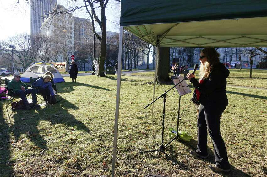 Karen Beetle with Capital District Border Watch speaks to those gathered at Academy Park for an encampment on Sunday, Jan. 12, 2020, in Albany, N.Y. The encampment is being held to show their support for the asylum-seekers at the U.S.-southern border living in tent encampments. (Paul Buckowski/Times Union)