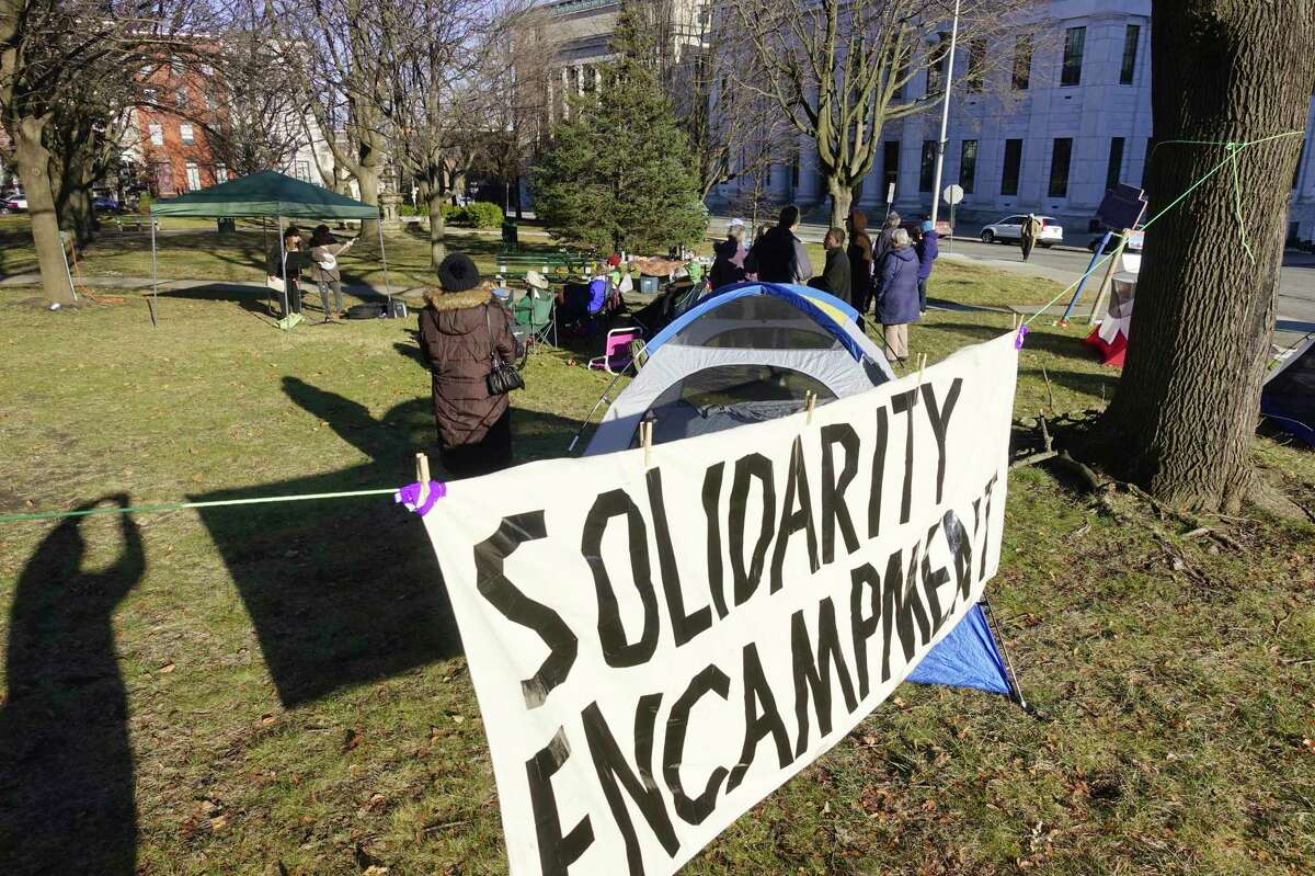 People gather at Academy Park for an encampment on Sunday, Jan. 12, 2020, in Albany, N.Y. The encampment is being held to show their support for the asylum-seekers at the U.S.-southern border living in tent encampments. (Paul Buckowski/Times Union)