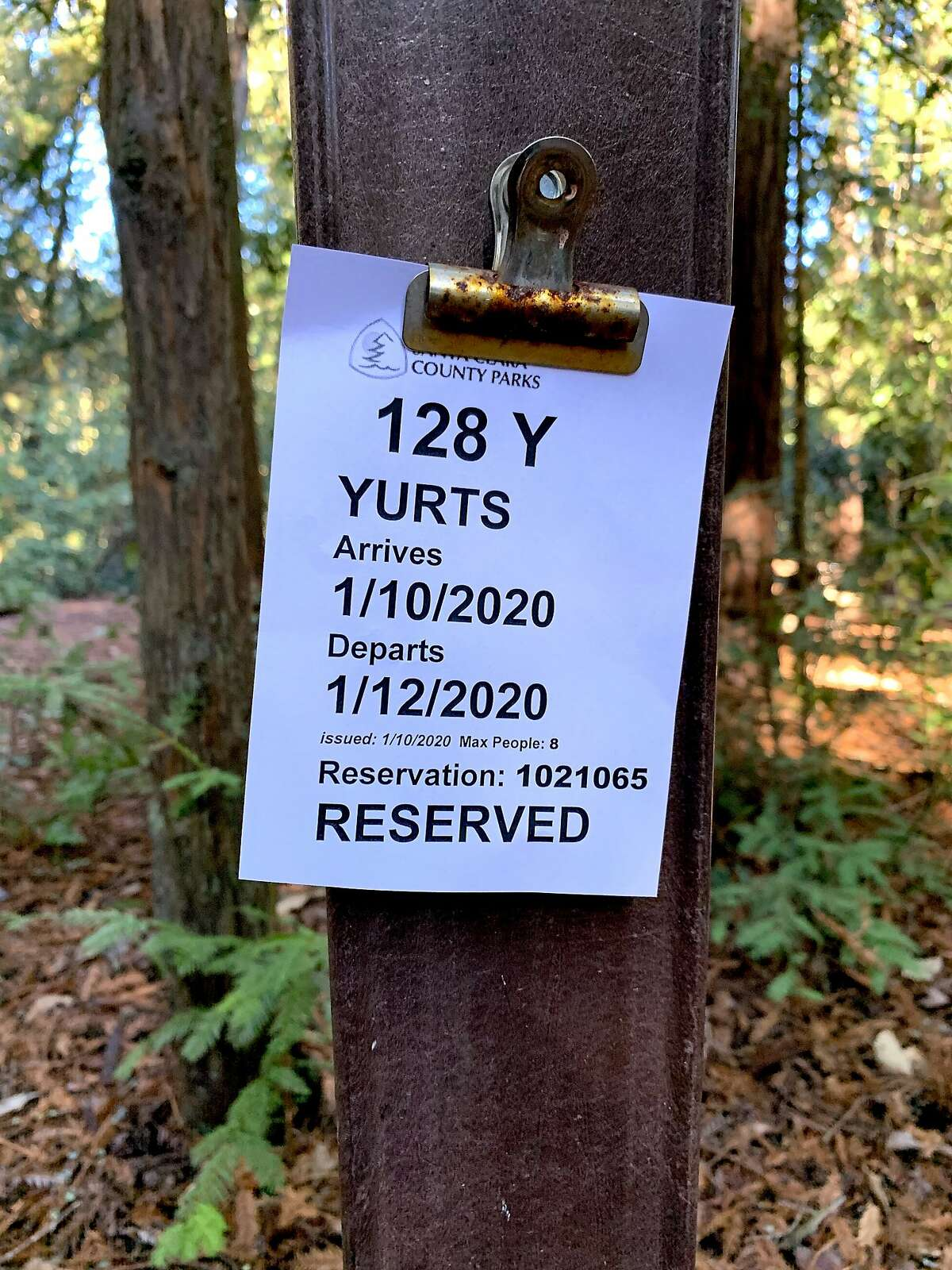 A sticker is affixed at entry of campsite to note yurt reservation and dates