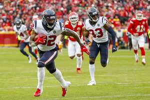 Houston Texans cornerback Lonnie Johnson (32) runs downfield with a blocked punt for a touchdown during the first quarter of an AFC divisional playoff game at Arrowhead Stadium on Sunday, Jan. 12, 2020, in Kansas City, Mo.
