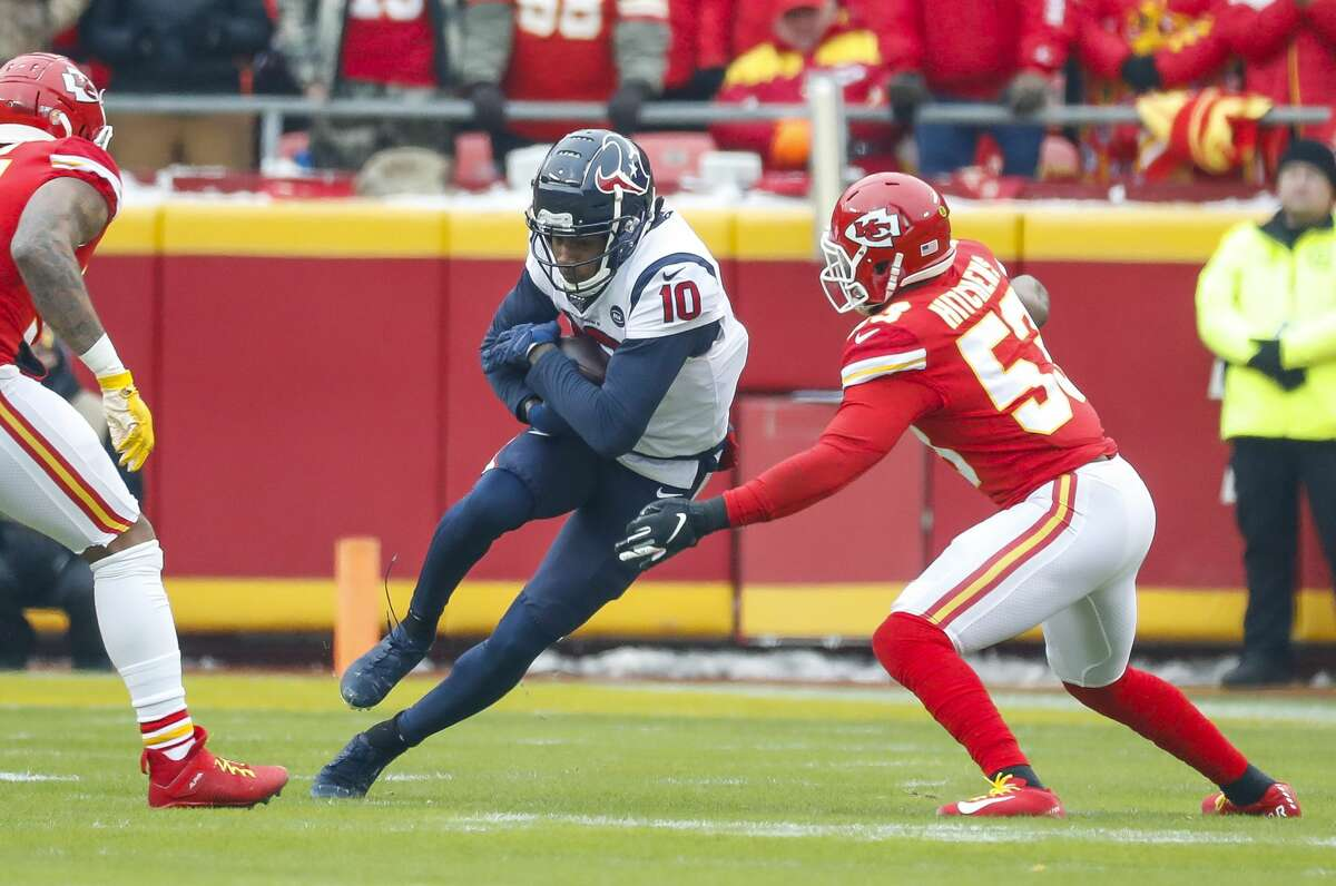 Houston Texans wide receiver DeAndre Hopkins (10) tries to run past Kansas City Chiefs inside linebacker Anthony Hitchens (53) during the first half of an AFC divisional playoff game at Arrowhead Stadium on Sunday, Jan. 12, 2020, in Kansas City, Mo.
