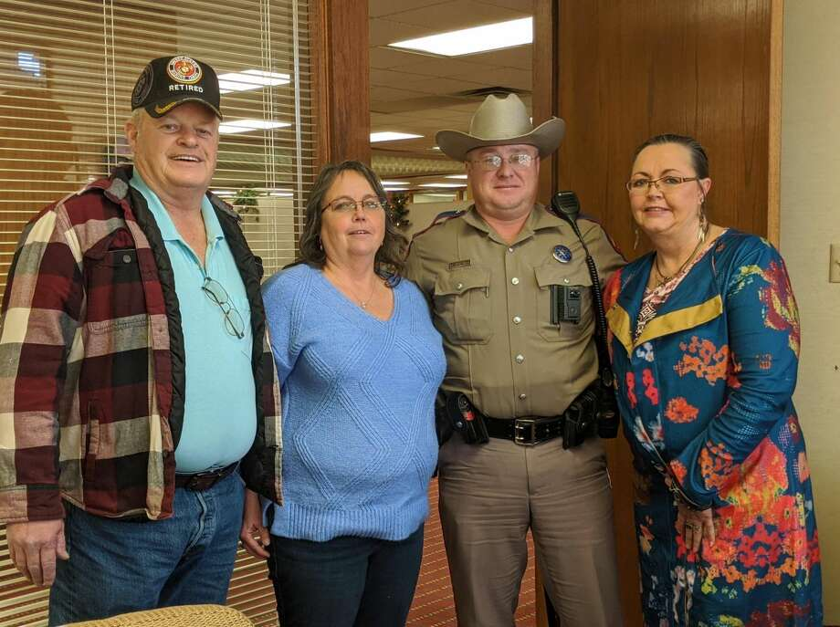 Brad Grimsley, who was injured in the mass shooting on Aug. 31, from left; his wife, Brenda; Texas Department of Public Safety Trooper Mike Baskerville; and Betty Perea, Brenda's sister, get together during the Grimsleys' trip back to Odessa in November. Photo: Courtesy Photo