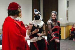Friendswood Youth Services Librarian Christina Hicks interviews Zombie Combie Elizabeth O'Donnell and Katherine Schultz during the cosplay contest at the Friendswood Library Zaki Con Sunday, Jan. 12.