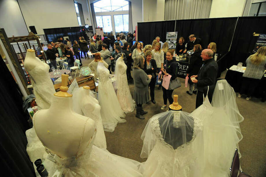 Visitors admire wedding dresses during Sunday's Bridal Show at Lewis and Clark Community College in Godfrey.
