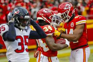 Houston Texans defensive back Keion Crossen (35) reacts as Kansas City Chiefs running back Darwin Thompson (34) and Dorian O'Daniel (44) celebrate during an AFC divisional playoff game at Arrowhead Stadium on Sunday, Jan. 12, 2020, in Kansas City, Mo.