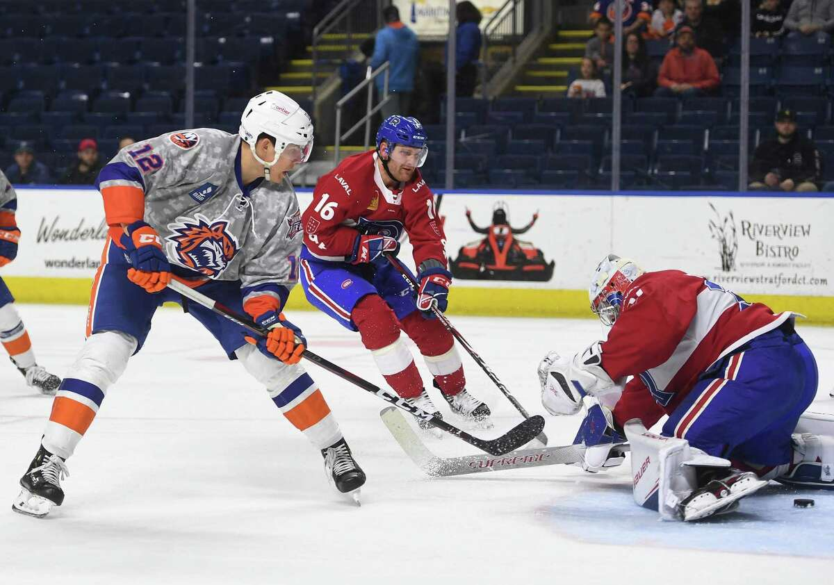 Bridgeport Sound Tiger forward Otto Koivula puts the puck through the legs of Laval Rocket goalie Cayden Primeau for his second goal of the first period during their AHL hockey game at the Webster Bank Arena in Bridgeport, Conn. on Sunday, January 12, 2020.