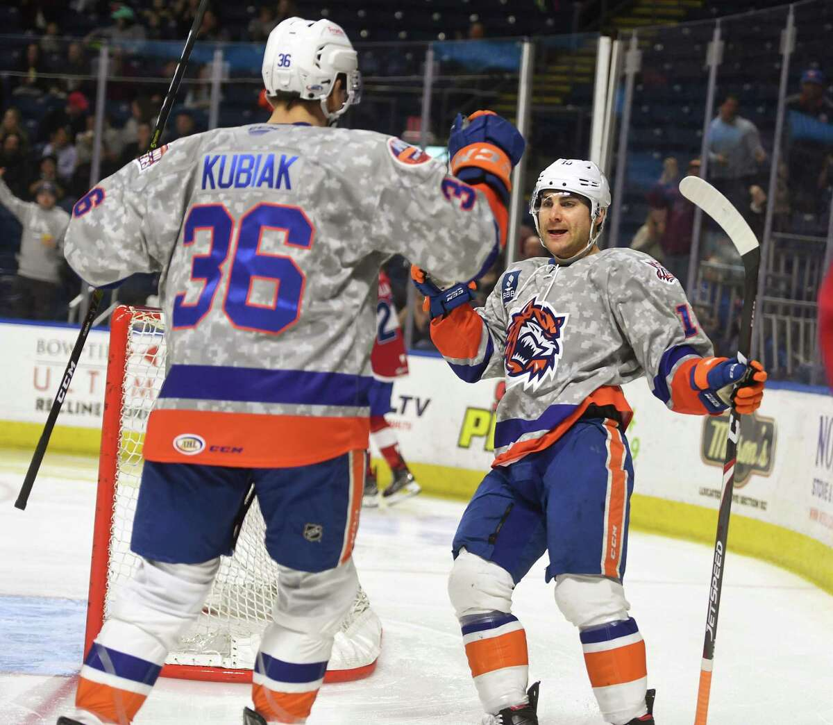 Bridgeport Sound Tigers Jeff Kubiak, left, and Ryan Bourque celebrate Bourque's first period goal during their AHL hockey game with the Laval Rocket at the Webster Bank Arena in Bridgeport, Conn. on Sunday, January 12, 2020.