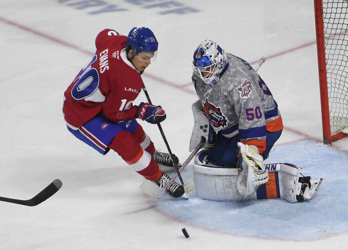 Bridgeport Sound Tiger goalie Jared Coreau makes a save on a breakaway by the Laval Rocket's Jake Evans in the second period during a game in January.
