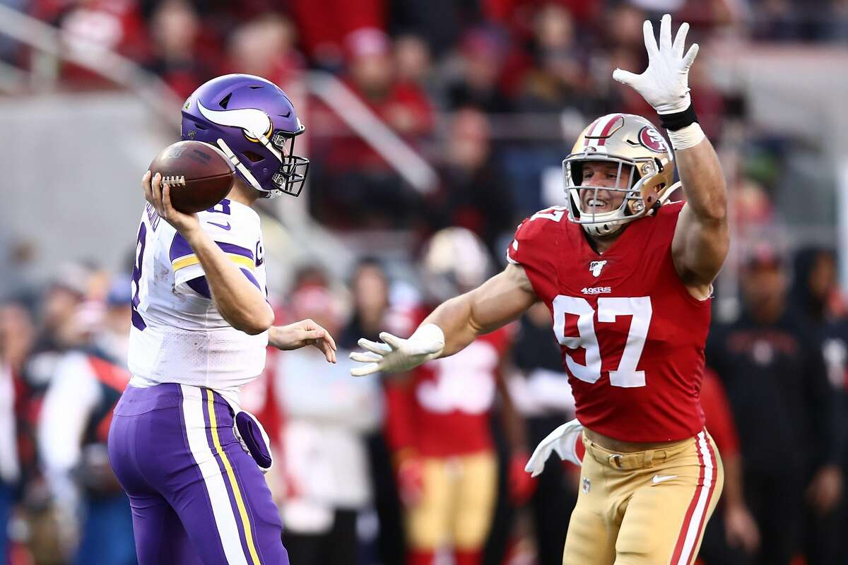 Kirk Cousins #8 of the Minnesota Vikings is pressured by Nick Bosa #97 of the San Francisco 49ers during the second half of the NFC Divisional Round Playoff game at Levi's Stadium on January 11, 2020 in Santa Clara, California. (Photo by Ezra Shaw/Getty Images)
