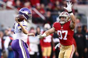 SANTA CLARA, CALIFORNIA - JANUARY 11: Kirk Cousins #8 of the Minnesota Vikings is pressured by Nick Bosa #97 of the San Francisco 49ers during the second half of the NFC Divisional Round Playoff game at Levi's Stadium on January 11, 2020 in Santa Clara, California. (Photo by Ezra Shaw/Getty Images)